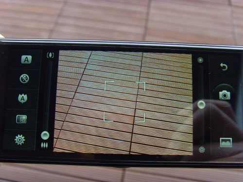 左邊的Scroll bar用來zoom; 右邊的Scroll bar用來節調曝光。