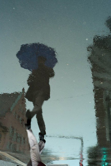 Blue umbrella reflection