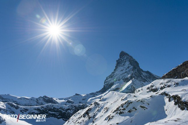 小光圈(f/14)可以令太陽光芒更突出,而且保持前後景於景深範圍內。