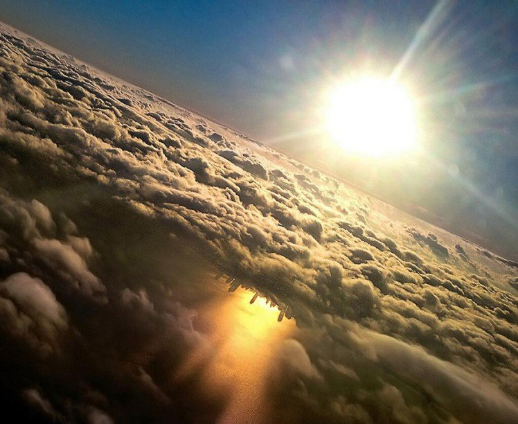 Photo by {link:http://www.boredpanda.com/chicago-skyline-reflection-lake-michigan-mark-hersch/}Marc Hersch{/link}