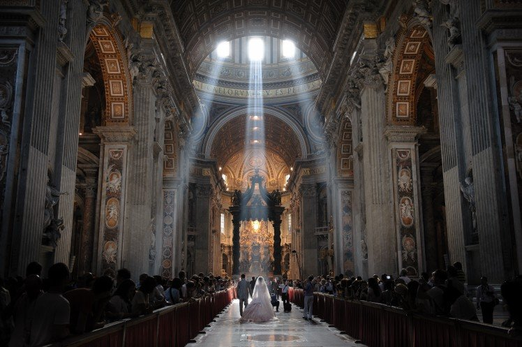 Blessed by the crepuscular rays at Saint Peter's Basilica.